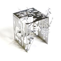 Mikro World is a series of fold-up metal sculptures created by British artist Sam Buxton that will add a touch of instant art to your desk or home. Each piece folds from a single sheet of stainless steel that is just 0.01 inches thick and packaged flat with folding instructions. The Mikro Cube Work depicts a luscious garden with vines, wild flowers and other flora in an ingenious design that creates walls with its single sheet of steel.