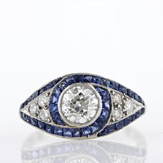 I love the low profile on this and the way the sapphires vanish in the overlap.