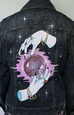 Hand painted denim jacket Original design of two hands around a crystal ball, surrounded by magic and stars. Simple but effective colour palette, with Painted Denim Jacket, Painted Jeans, Painted Clothes, Hand Painted, Diy Clothing, Custom Clothes, Diy Fashion, Ideias Fashion, Textiles Y Moda
