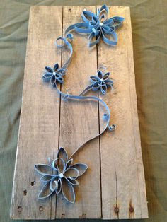 Wall Art using pallet boards and toilet paper rolls.