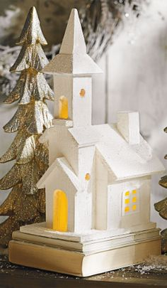 Create a cozy and evocative display with our collection of Illuminated Wooden Houses.