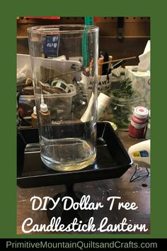 My craft stash is overflowing with so many glass pieces. Let me show you how I made my diy dollar tree candlestick lantern. Decorating With Snowmen, Primitive Christmas Decorating, Snowman Decorations, Christmas Tree Decorations, Decorating Ideas, Cricut Christmas Ideas, Christmas Sewing, Primitive Candles, Primitive Snowmen
