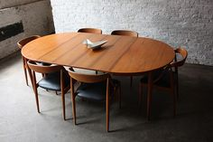 Breathtaking Johannes Andersen Danish Modern Teak Dining Table and Chairs (Denmark, by Kinzco // From Foter. Scandinavian Dining Table, Teak Dining Table, Extendable Dining Table, Dining Room Chairs, Dining Furniture, Table And Chairs, Furniture Design, Lounge Chairs, Retro Dining Table