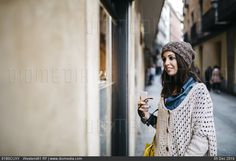 Spain, Barcelona, smiling young woman in the city looking at shop window - stock photo