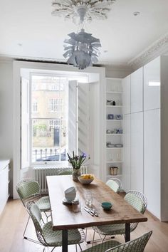 Jane's Heritage-Contemporary in London — House Call I love the chairs with great print seat pads- the ginormous window and unique lighting choice
