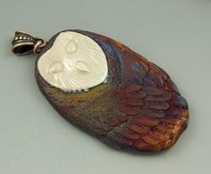 Raku Barn Owl Pendant by elementspottery on Etsy, $15.00.....SO COOL