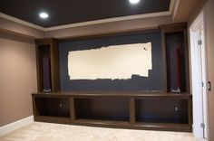 Our home theater is almost complete.  The cabinets were built and the entire space was repainted a little over a week ago. The projector   h...