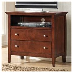 Found it at Wayfair - Whiskey 2 Drawer Media Chest. It might be a little tall.