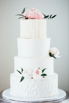 Four tier white floral topped wedding cake: Photography: Eva Lin Photography - www.evalinphotography.com/   Read More on SMP: http://www.stylemepretty.com/2016/07/12//