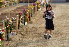 Girl on her way to her father's grave 2 months after Japanese tsunami