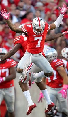 Ohio State Buckeyes cornerback Damon Webb (7) and linebacker Chris Worley (35) react after the defense stopped Indiana from converting on 4th down in the fourth quarter