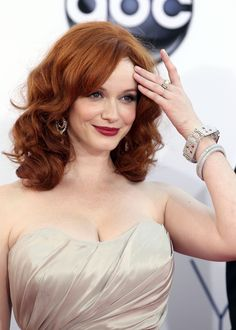 Polished beauty Christina Hendricks ...  Phenomenal spectacle of female beauty...   Hendricks has been credited as having an ideal shape for a woman.