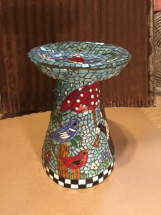 Another view of handmade birdbath by Rhonda Kretzer Studio.  Hand cut stain glass and my own design.  Designs are my own work and not tone replicated