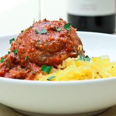 Slow carb meatballs using beans and vegetables instead of breadcrumbs, served with spaghetti squash.