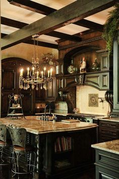 Stunning green cabinetry with matching ceiling beams. The chandelier provides a nice touch.