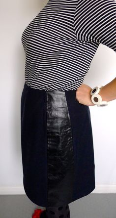 Leather and wool skirt--love the black on black.