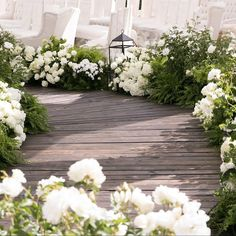 Instead of a traditional white aisle runner, imagine a path like this one lined…