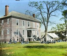 """According to Pulitzer Prize-winning historian James McPherson, """"The Civil War started because of uncompromising differences between the free and slave states over the power of the national government to prohibit slavery in the territories that had not yet become states."""" Pictured: Union soldiers resting at a plantation house in Virginia."""