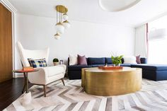living room with white gold pendant lights