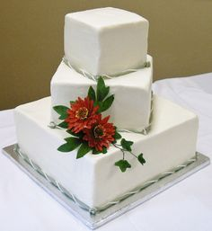 Square off set cakes - I made gumpaste flowers to accent this buttercream iced cake