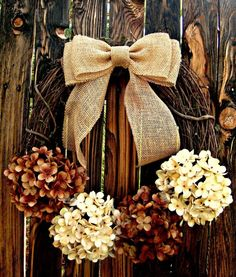 Chocolate and Cream: The dark brown and off-white flowers on this rustic wreath are very autumn-appropriate. Click through for more festive fall wreaths!