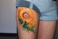 sunflower thigh tattoo - 45 Inspirational Sunflower Tattoos