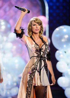 Taylor Swift  on runway at the annual Victoria's Secret fashion show - December 2, 2014 in London.