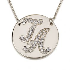 Dress up any outfit and go out and make a statment with this gorgeous initial necklace sparkling with imitation diamonds.