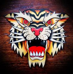 Wonderful old school roaring tiger head tattoo design - Tattooimages ...