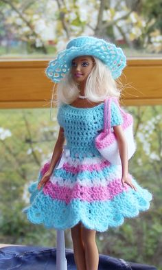 Knitting Patterns combine Crochet beautiful doll clothes yourself! With the clothes series 'Swing' you can for Eur …Crochet lovely doll garments your self! With the garments collection 'Swing' you may on your kids and grandchildren probably the mos Crochet Doll Dress, Crochet Barbie Clothes, Doll Clothes Barbie, Barbie Outfits, Barbie Dress, Barbie Clothes Patterns, Clothing Patterns, Barbie Mode, Crochet Fashion