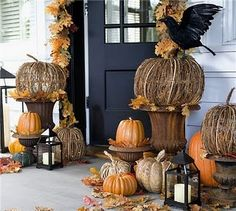fall porch decor.  I love the crow...it could transition nicely into Halloween decor.