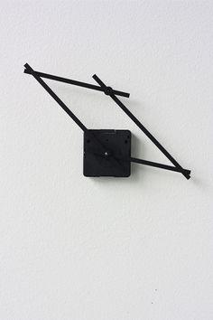'hand in hand clock' designed by yenwen tseng