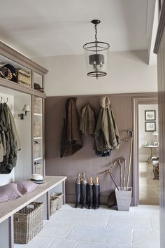 A pink (or is it purple) color for the mud room in this 16th century home that has reclaimed its natural elegance with an added injection of modern energy.   Designed by SIMS Hilditch