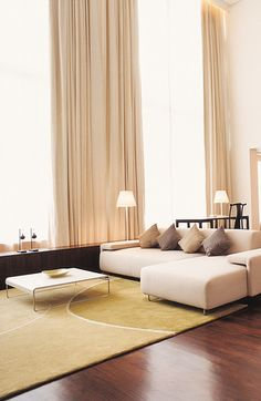 Your comfortable lounge area in the COMO suite in #MetBangkok is illuminated by tall windows.