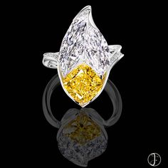 FORMS Jewellery. Two marquise-shaped diamonds are invisibly set at an angle, giving life to a rich vivid yellow cushion. #formsjewellery #highjewellery