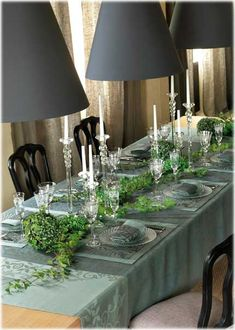beautiful table setting tall candle sticks and ivy twined down table setting