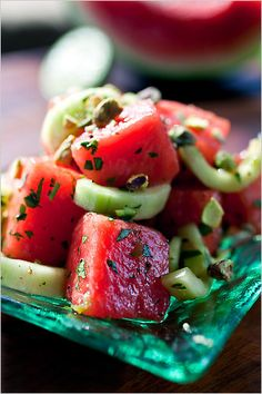NYT Cooking: Asian (hoisin sauce) and Mexican (jalapeño) combine in this bright summer salad, which takes advantage of a seasonal favorite, watermelon and the ever-reliable cucumber. Flat-leaf parsley adds specks of deep green, and pistachios add crunch. Cucumber Watermelon Salad, Watermelon Healthy, Watermelon Mint, Fruit Salad, Healthy Recipes, Cooking Recipes, Dishes Recipes, Top Recipes, Summer Recipes