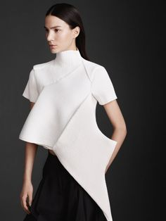 Experimental Fashion Construction - sculptural white top with strong line & shape detail; 3D fashion silhouette // JW Anderson