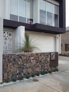Corton steel and gabion at entrance with name/logo