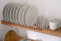 Steal This Look: A Scandi-Style Kitchen in a Canadian Cabin A custom shelf by Peter Henderson Furniture features slots for storing plates. Go to Peter Henderson for more information. See more in our post 10 Easy Pieces: Wall-Mounted Plate Racks. Plate Racks In Kitchen, Kitchen Wall Shelves, Kitchen Storage, Diy Plate Rack, Wooden Plate Rack, Plate Rack Wall, Kitchen Drying Rack, Wooden Dish Rack, Drying Racks