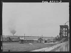 Sandusky, Ohio. Looking across the Pennsylvania Railroad docks from number one dock to number three dock. In the background, a switch engine is bringing in a trainload of coal | Library of Congress