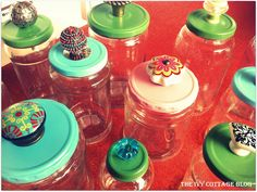diy - Reuse glass jars by removing stickers with goo gone, spray paint lids, punch hole in lid with screwdriver and add drawer knob with nut on underside