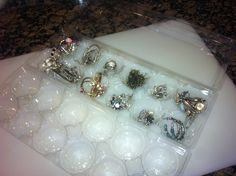 My husband came up with the brilliant idea to use egg cartons as jewelry storage!  It works great for smaller jewelry like rings and earrings and they are stackable!  Nice!