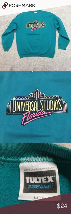 Vintage Universal Studios FL sweatshirt teal L Universal Studios Florida vintage crewneck sweatshirt. Teal with bright logo. Approximate flat lay measurements: chest 22in, length 25in. Oversized - may have originally been a men's large. Vintage Tops Sweatshirts & Hoodies