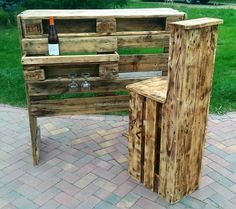 People who love to enjoy the weather while sipping their favorite drink can copy this idea, buying a bar from the market can cost too much; so it is good to restyle the wood pallets into recycled wooden pallet patio bar as shown here. The chair style is innovative and the bar contains the space to fix the glasses as well.