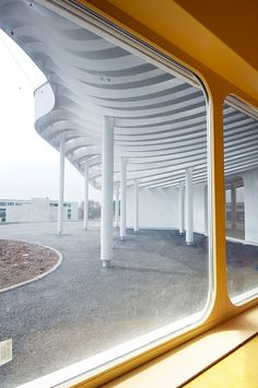 childcare facility in boulay, france designed by paul le quernec | curving, undulating roof