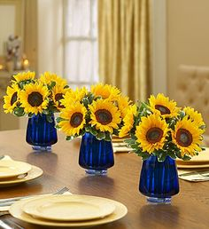 Sunflower Centerpieces in cobalt vases
