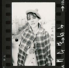Anna Karina in plaid coat and beret