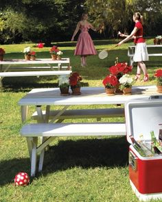 Like the centrepieces and idea of using picnic blankets - like idea of red and white 'picnic' blankets mid table settings