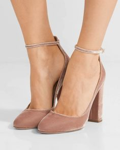 Aquazzura's 'Alix' pumps are the easiest way to incorporate the season's velvet trend into your fall capsule. Cut from the plush material, this blush pair has a flattering almond toe and Mary Jane-inspired ankle strap to temper the sizable block heel. They will add rich texture and a feminine edge to day or